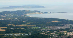 view from top of Sugarloaf across Bray to Howth illustrating a post about walking Sugarloaf
